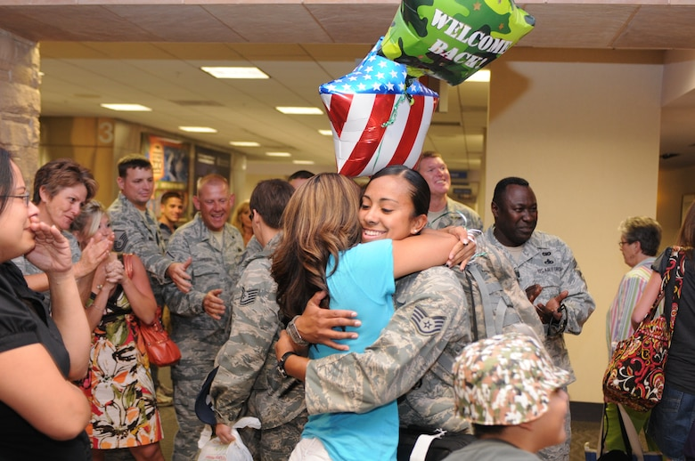 Staff Sgt. Patricia Pacheco is welcomed home after a five-month deployment to Iraq, June 7. Family and friends celebrated the return of 29 security forces Airmen assigned to the 162nd Fighter Wing at Tucson International Airport. (Air Force photo by Maj. Gabe Johnson)