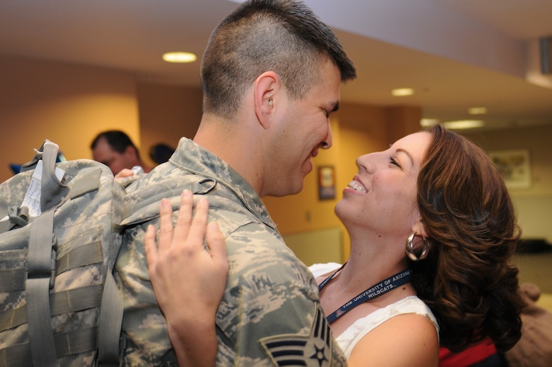 Senior Airman Francisco Rodriguez is welcomed home after a five-month deployment to Iraq, June 6. Family and friends celebrated the return of 29 security forces Airmen assigned to the 162nd Fighter Wing at Tucson International Airport. (Air Force photo by Maj. Gabe Johnson)