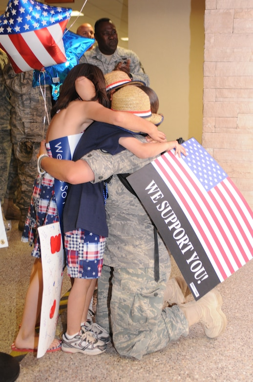 Staff Sgt. Boradel Medrano is welcomed home after a five-month deployment to Iraq, June 6. Family and friends celebrated the return of 29 security forces Airmen assigned to the 162nd Fighter Wing at Tucson International Airport. (Air Force photo by Maj. Gabe Johnson)