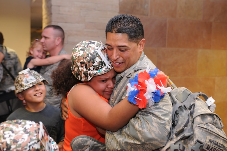 Tech. Sgt. Ernesto Marquez is welcomed home after a five-month deployment to Iraq, June 7. Family and friends celebrated the return of 29 security forces Airmen assigned to the 162nd Fighter Wing at Tucson International Airport. (Air Force photo by Maj. Gabe Johnson)