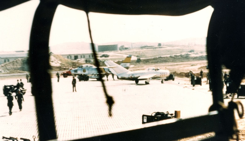 Lt. No Kum-Sok's MiG-15bis next to an F-86 at Kimpo Air Base about five minutes after he had landed. This photo was taken without permission from the rear of a passing truck. (U.S. Air Force photo)