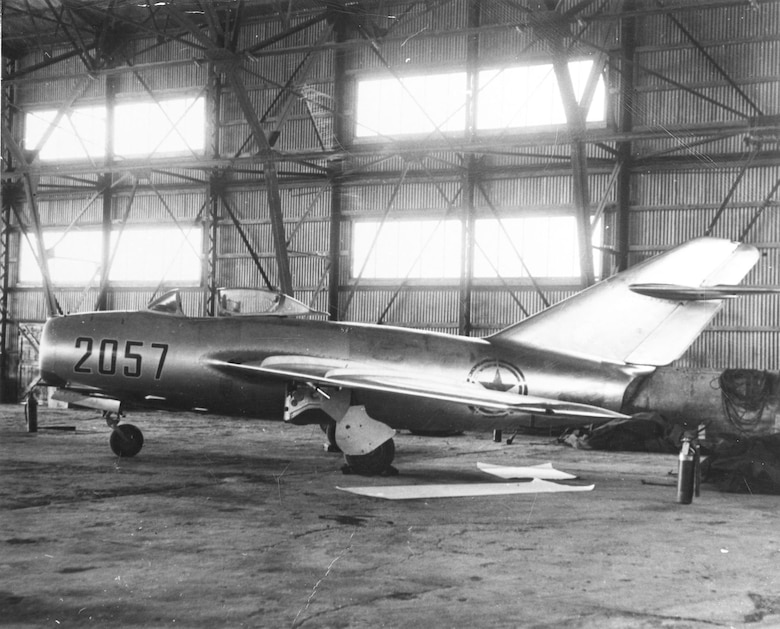 The MiG-15b is secured in a hangar at Kimpo Air Base. (U.S. Air Force photo)