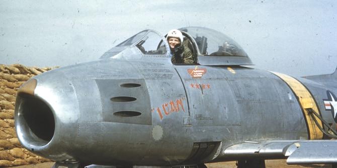"Capt. Iven C. Kincheloe Jr. in the cockpit of ""Ivan,"" the F-86E he flew in combat in Korea. (U.S. Air Force photo)"