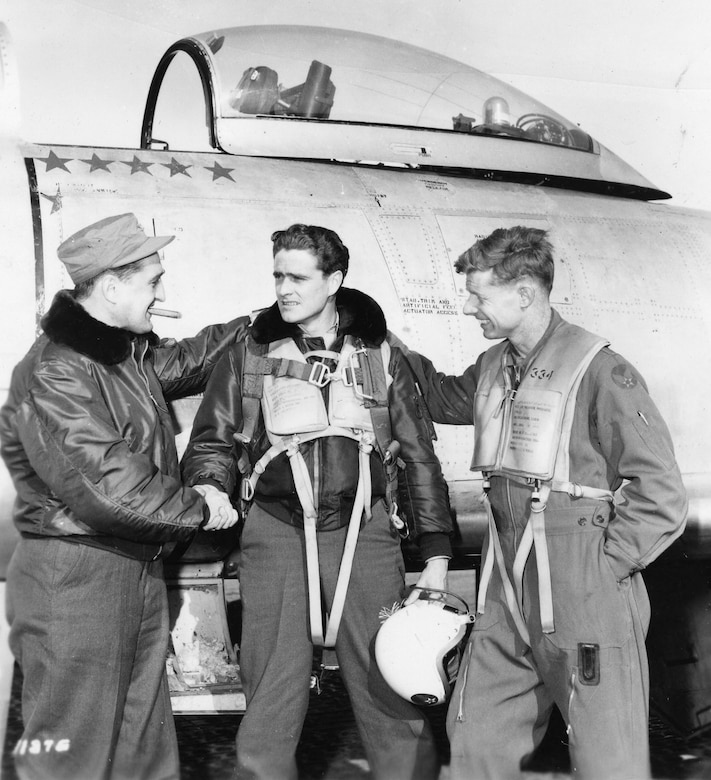 Francis S. Gabreski (left) congratulates another World War II and Korean War ace, Maj. William T. Whisner (center). On the right is Lt. Col. George Jones, a MiG ace with 6.5 kills. (U.S. Air Force photo)