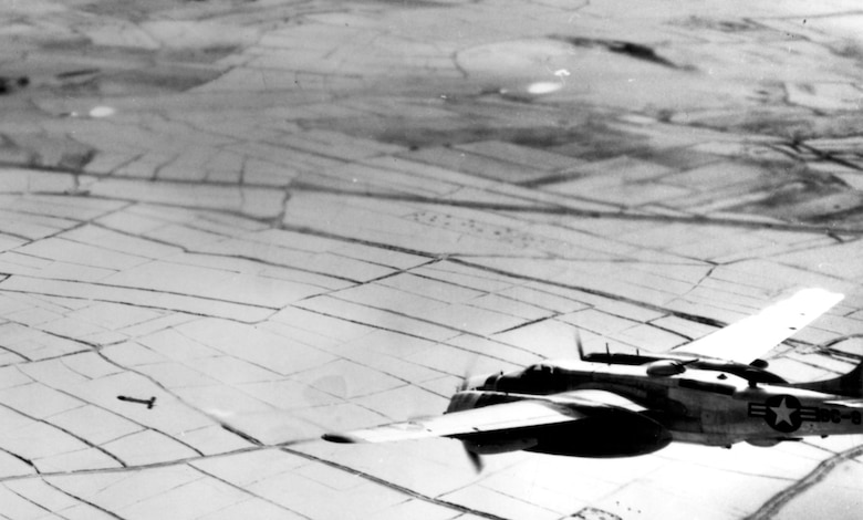 B-26 on an attack run fires one of its 5-inch rockets. In the top part of the photo are two rockets fired from another B-26. (U.S. Air Force photo)