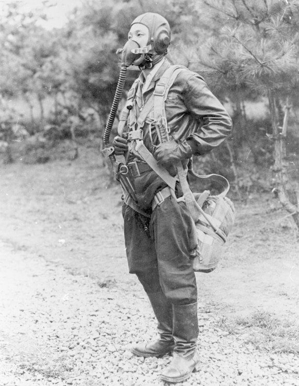 Lt. No Kum-Sok in the flying clothing and equipment he wore on his flight to South Korea. (U.S. Air Force photo)