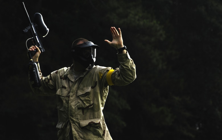 An Airman surrenders after taking a direct hit during the Commander's Fitness Challenge paintball tournament at the base picnic grounds June 4, 2010, at Joint Base Charleston, S.C. The tournament was organized by the Outdoor Recreation Center. (U.S. Air Force photo/Airman 1st Class Lauren Main)