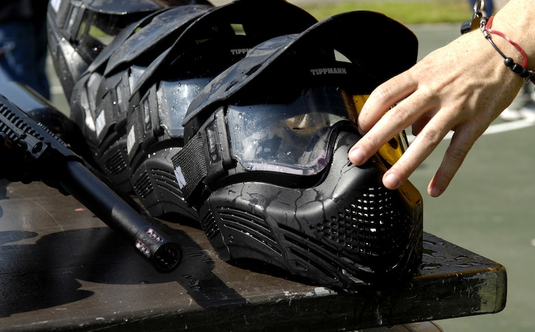 A competitor reaches for a paintball facemask at the base picnic grounds on Joint Base Charleston, S.C., June 4, 2010, for protection against the high speeds the paintballs reach. (U.S. Air Force Photo/Airman 1st Class Lauren Main)