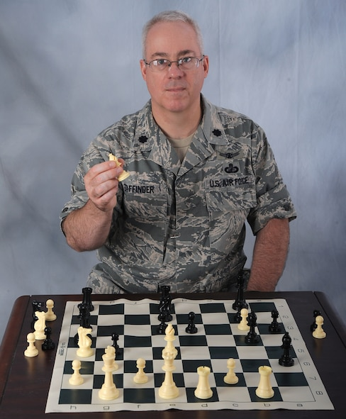 OFFUTT AIR FORCE BASE, Neb. -- Lt. Col. Douglas Taffinder poses for a studio photo after winning the 2010 Air Force Chess Tournament May 15 at Wright-Patterson AFB, Ohio. The lieutenant colonel, assigned to U.S. Strategic Command Headquarters, will now represent the Air Force during the 2010 Inter-service Championships set for Aug. 2 - 6 at Naval Station Great Lakes, Ill. U.S. Air Force photo by D.P. Heard