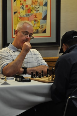 WRIGHT-PATTERSON AIR FORCE BASE, Ohio -- Lt. Col. Douglas Taffinder contemplates his next move during the 2010 Air Force Chess Tournament here May 15. The lieutenant colonel, assigned to U.S. Strategic Command Headquarters at Offutt AFB, Neb., was crowned the Air Force chess champion and will represent the service during the 2010 Inter-service Championships set for Aug. 2 - 6 at Naval Station Great Lakes, Ill. U.S. Air Force photo by Ryan P. Burger