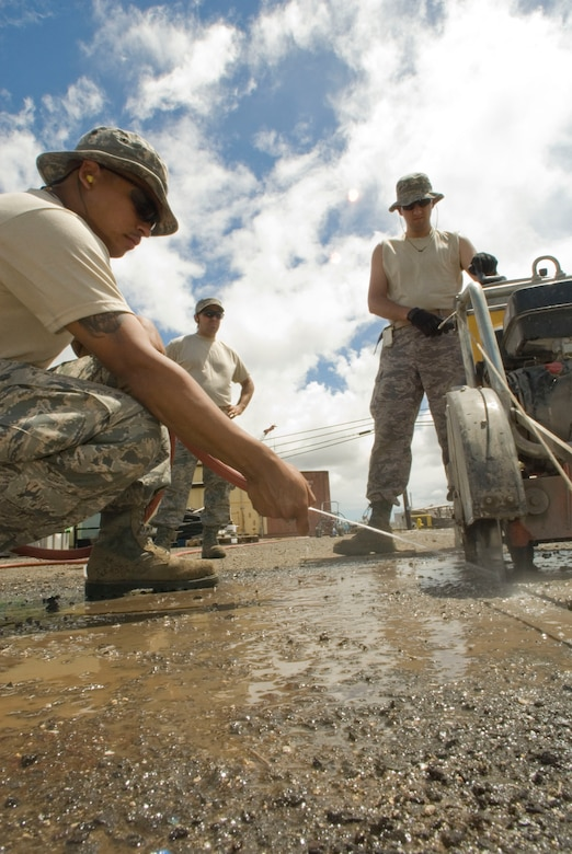 Airmen from the 146th Civil Engineering Squadron begin work together cutting the concrete on a construction site on Pearl City's Naval base in Hawaii June 7, 2010. The Civil Engineering Squadron will be assisting with various construction projects over the course of two weeks including Barbers Point Coast Guard Base. (DoD photo by Airman 1st Class Nicholas Carzis, U.S. Air Force/Released)