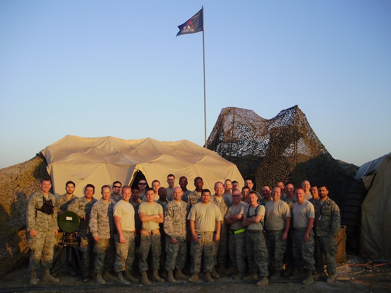 Members of the 32nd Combat Communications Squadron,34th CBCS and 3rd Combat Communications Support Squadron, Tinker Air Force Base, Okla. pose for a group photo early in their deployment to Haiti while the unit was at full strength. Members of the 3rd Combat Communications Group were supporting relief efforts in Haiti since February and the last remaining members returned home in June. (US Air Force photo)
