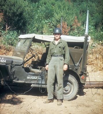 USAF Tactical Air Control Party (TACP) radioman with his jeep at the front lines in 1952. Air Force radio jeeps were easily identified by the large silver antennae protruding above the roof. (U.S. Air Force photo)