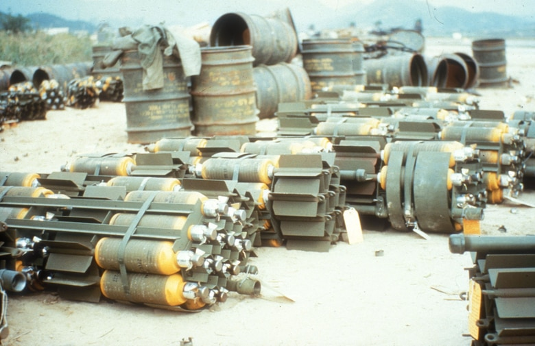 Bomb dump with several M26A1 bomb clusters. Each one scattered 20 20-lb. fragmentation bombs as it fell. This weapon was effective against enemy troops and trucks. (U.S. Air Force photo)