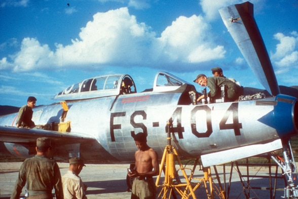 Maintainers working on an F-84 Thunderjet. (U.S. Air Force photo)