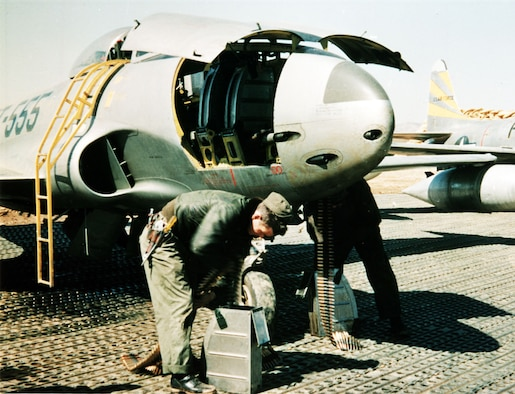 Armorers loading the six .50-cal. machine guns of an F-80C. (U.S. Air Force photo)