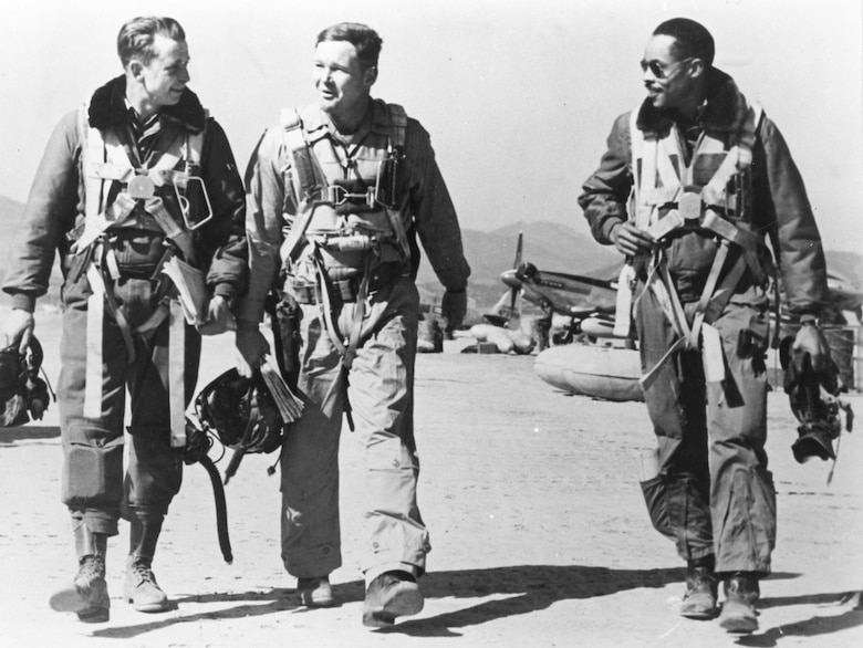 F-51 pilots returning from a mission. (Left to right) 1st Lt. George McKee, Capt. Samuel Sanders and Capt. Leroy Roberts, a former Tuskegee Airman. (U.S. Air Force photo)