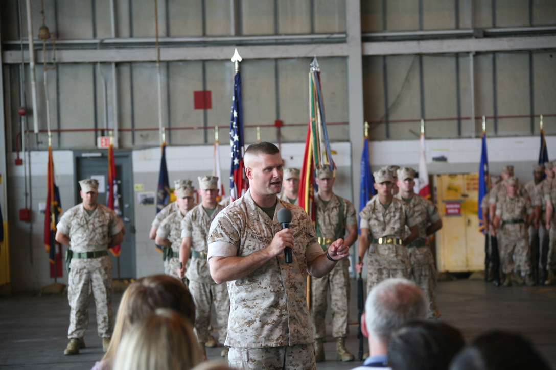 Lt. Col. Kirk Nothelfer, new commanding officer for Marine Tactical Electronic Warfare Squadron 3, speaks to friends and families of VMAQ-3 Marines during the change of command ceremony, June 10.