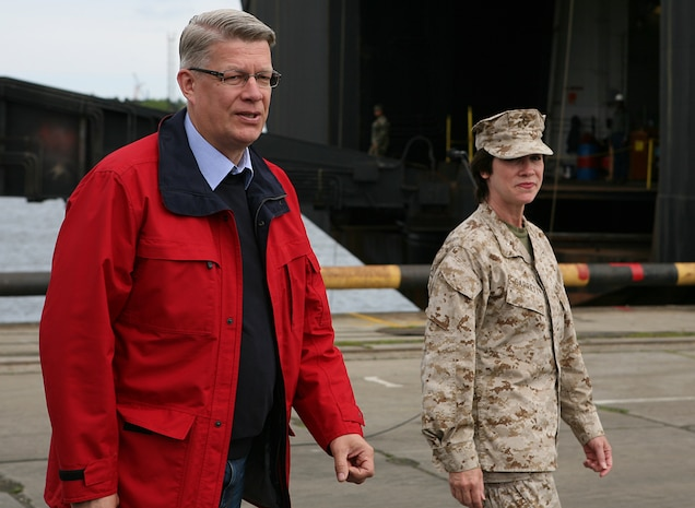 Latvian President Valdis Zatlers (left) walks with Maj. Gen. (sel.) Tracy L. Garrett, commanding general of the 4th Marine Logistics Group, prior to a distinguished visitor event at several sites around the exercise Baltic Operations 2010 training areas. Since the start the exercise on June 6th, the Marines and Sailors of 4th Landing Support Battalion and Naval Beach Group 2 have been working with members of the Armed Forces of Latvia to conduct maritime preposition force offload operations here.