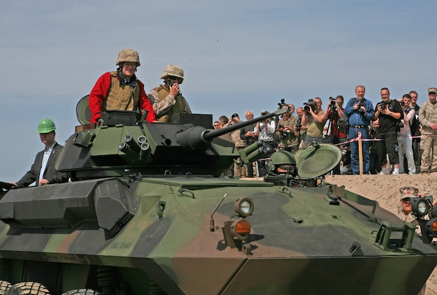 Latvian President Valdis Zatlers (in red on top of vehicle) rides a Light Armored Reconnaissance Vehicle through the beach entry access point constructed to aid maritime preposition force offload exercises and increase access to local recreation areas here. President Zatlers visited the Marines and Sailors of 4th Landing Support Battalion and Naval Beach Group 2, who have been working together with Latvian forces to conduct maritime preposition force offload operations and other training events here since the start of the exercise June 6.