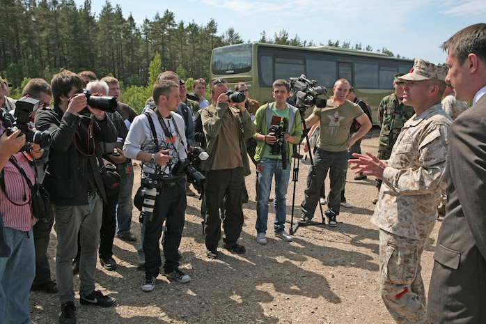Lt. Col. James C. McDonald (right), commanding officer of 4th Landing Support Battalion, provides Latvian and international media representatives with an overview of what the Navy and Marine Corps participants in exercise Baltic Operations 2010 are doing at the logistics support area here. Since the start the exercise on June 6th, the Marines and Sailors of 4th Landing Support Battalion and Naval Beach Group 2 have been working with members of the Armed Forces of Latvia to conduct maritime preposition force offload operations and other training both at sea, and ashore here.