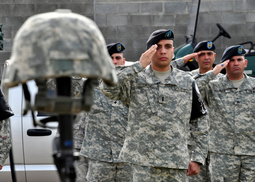 Joint Security Forces members at Soto Cano Air Base, Honduras, pay tribute June 8 to Army Staff Sgt. Randall Harris, who was killed June 13, 1987 while performing security duty at the front gate of the air base. Sergeant Randall deployed from the 978th Military Police Company at Fort Bliss, Texas in support of Joint Task Force-Bravo. (U.S. Air Force photo by Staff Sgt. Bryan Franks)