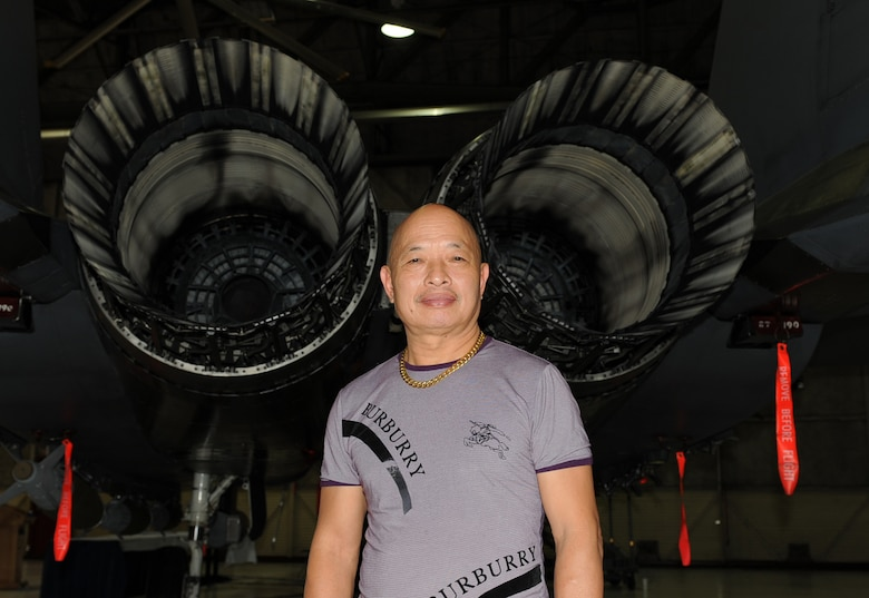 SEYMOUR JOHNSON AIR FORCE BASE, N.C. -- Nguyen Hong My poses in front of an F-15E Strike Eagle here June 4, 2010. Mr. Hong My toured the base with retired Brig. Gen. Dan Cherry, who shot down Mr. Hong My's MiG 21 during the Vietnam War. Mr. Hong My, a former lieutenant in the Vietnamese Air Force, hails from Hanoi, Vietnam. (U.S. Air Force photo/Senior Airman Gino Reyes)