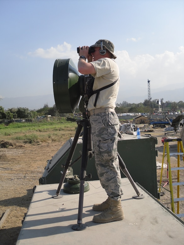 First Lt. Jake Cadwell, with the 3rd Combat Communications Group, sets up a line-of-sight microwave transmitter, providing wireless communications services to another part of the Toussaint Louverture Airport in Port au Prince.Air Force photo