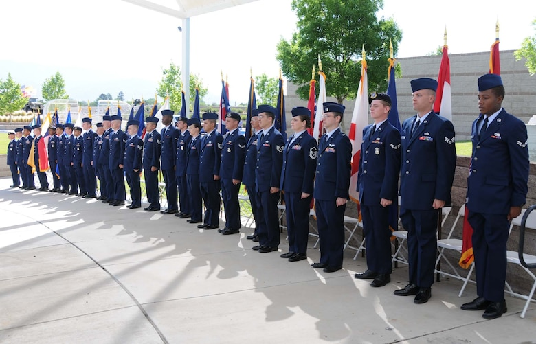 Team Kirtland volunteers participated in the parade of state flags during the Memorial Day observance at the New Mexico Veterans Memorial. A large audience gathered May 31 to honor those who have made the ultimate sacrifice for their country.  Air Force Photo by Dennis Carlson