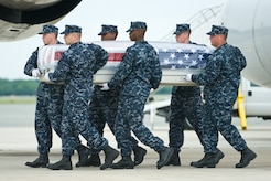 A U.S. Navy team transfers the remains of Navy Petty Officer 3rd Class Zarian A. Wood, of Houston, Texas, at Dover Air Force Base, Del., May 17. Petty Officer Wood was assigned as a hospital corpsman to Third Battalion, First Marine Regiment, First Marine Division, I Marine Expeditionary Force. (U.S. Air Force photo/Roland Balik)
