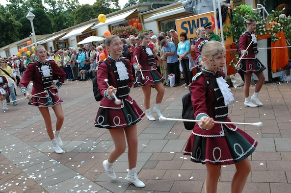 SPANGDAHLEM AIR BASE, Germany -- A group of local cheerleaders walk in a previous Rheinland-Pfalz Tag parade. This year's parade, which is an event featuring 4,000 participants made up of 130 groups from all over the state, will take from 3-5 p.m. June 13. (U.S. Air Force photo/Iris Reiff)