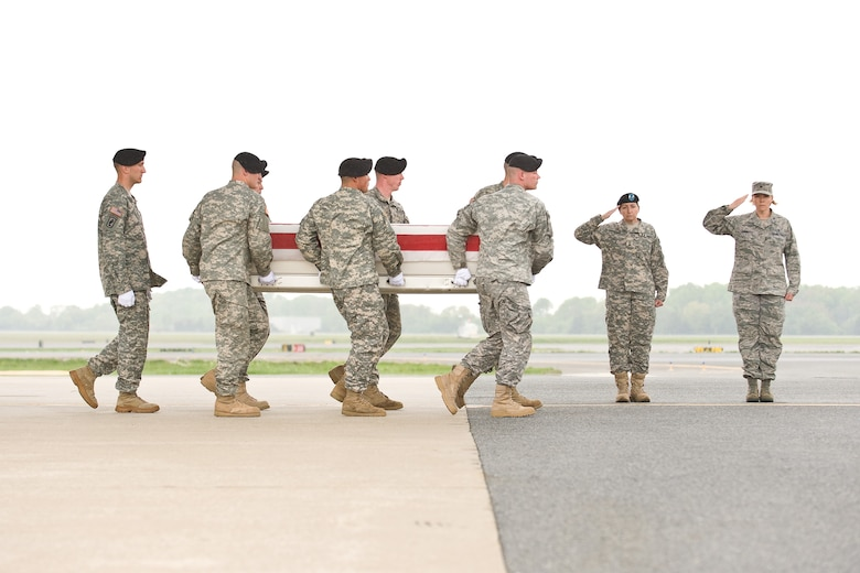 A U.S. Army carry team transfers the remains of Army Pfc. Charlie C. Antonio, of Kahului, Hawaii, at Dover Air Force Base, Del., April 21. (U.S. Air Force photo/Roland Balik)