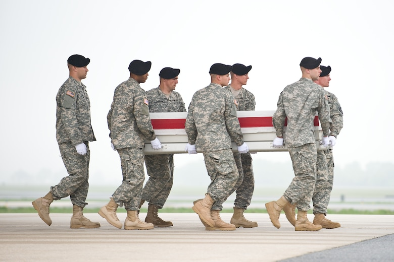 A U.S. Army carry team transfers the remains of Army Sgt. Jason A. Santora, of Farmingville, N.Y., at Dover Air Force Base, Del., April 25. Sgt. Kubik was assigned to the 3rd Battalion, 75th Ranger Regiment, Fort Benning, Ga. (U.S. Air Force photo/Roland Balik)