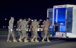 29 April 2010  USAF Photo by Jason Minto.  A U.S. Army carry team transfers the remains of Army SGT Keith A. Coe of Auburndale, FL. at Dover Air Force Base, Del., Apr 29, 2010.
