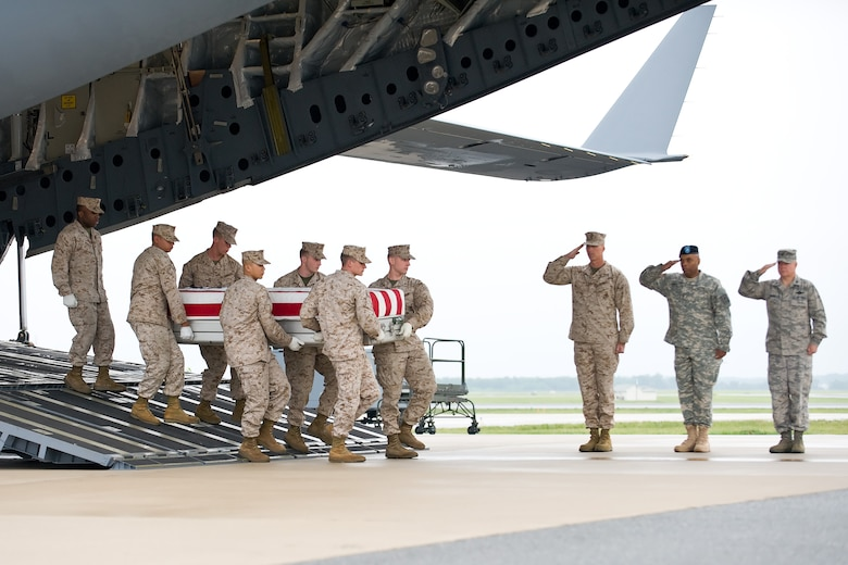 A U.S. Marine Corps team transfers the remains of Marine Corps Cpl. Kurt S. Shea, of Frederick, Md., at Dover Air Force Base, Del., May 12. Cpl. Shea was assigned to 3rd Battalion, 10th Marine Regiment, 2nd Marine Division, II Marine Expeditionary Force, Camp Lejeune, N.C. (U.S. Air Force photo/Roland Balik)