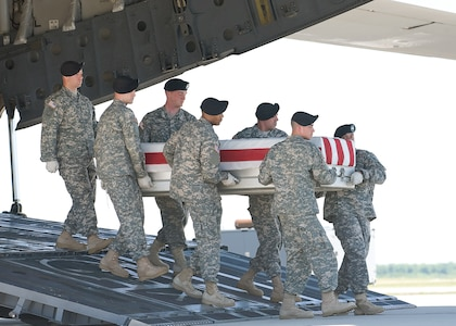 A U.S. Army carry team transfers the remains of Army SSgt Shane S. Barnard of Desmet, S.D., at Dover Air Force Base, Del., on May 20, 2010.  (U.S. Air Force photo/Brianne Zimny)