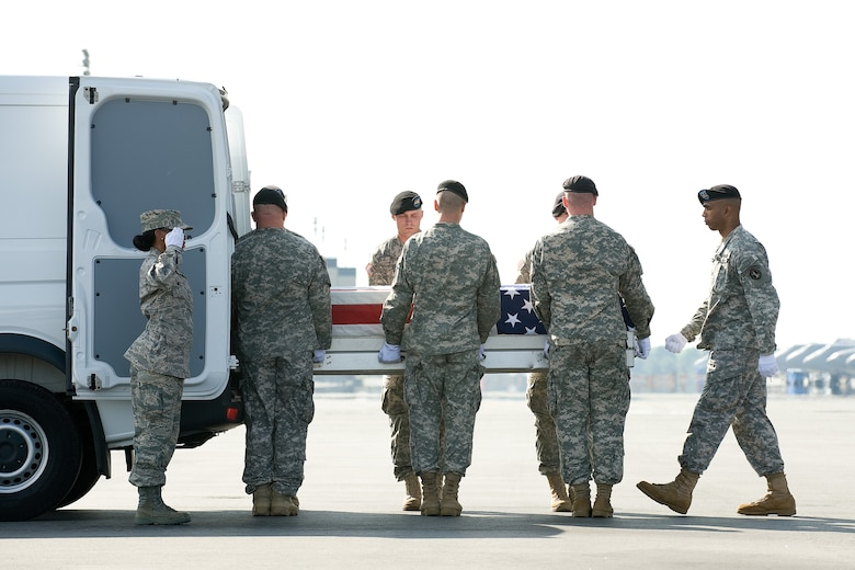 26 May 2010  USAF Photo by Jason Minto.  A U.S. Army carry team transfers the remains of Army SPC Christopher Ryan Barton of Concord, NC. at Dover Air Force Base, Del., May 26, 2010.