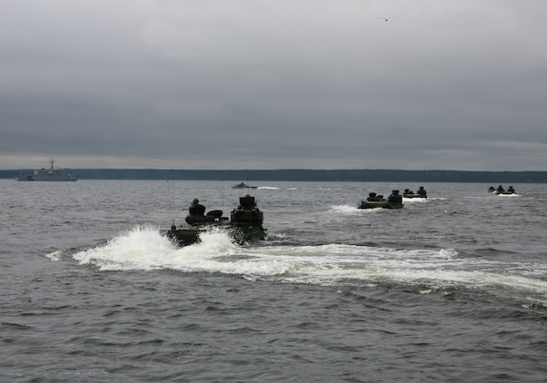 U.S. Marines amphibious assault vehicles head for the beach during a combined U.S., Estonian amphibious landing at a beach here. The combined training demonstration was part Baltic Operations 2010, an exercise designed to increase the interoperability of NATO and partner nations in the Baltic Sea region.