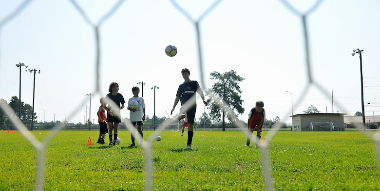 MOODY AIR FORCE BASE, Ga. -- Children perform drills that challenge them to kick the ball on top of the net during a Major League Soccer camp here June 11. Most of the drills were done consecutively and became more challenging as the day went on. (U.S. Air Force photo by Airman 1st Class Joshua Green/RELEASED)