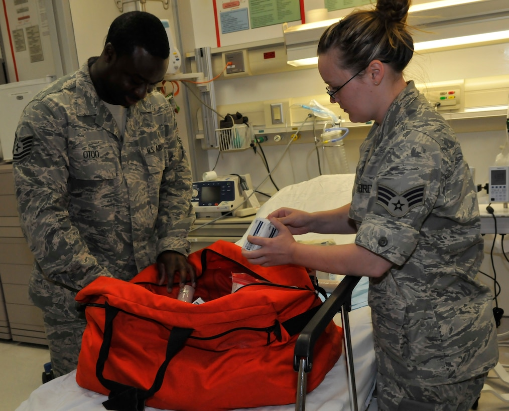 JOINT BASE ANDREWS, MD. – Senior Airman Hannah Poe and Tech. Sgt. Eric Otoo, from the 779th Medical Wing, prepare a hurricane emergency kit. (U.S. Air Force photo by Public Affairs Officer Melanie Moore)