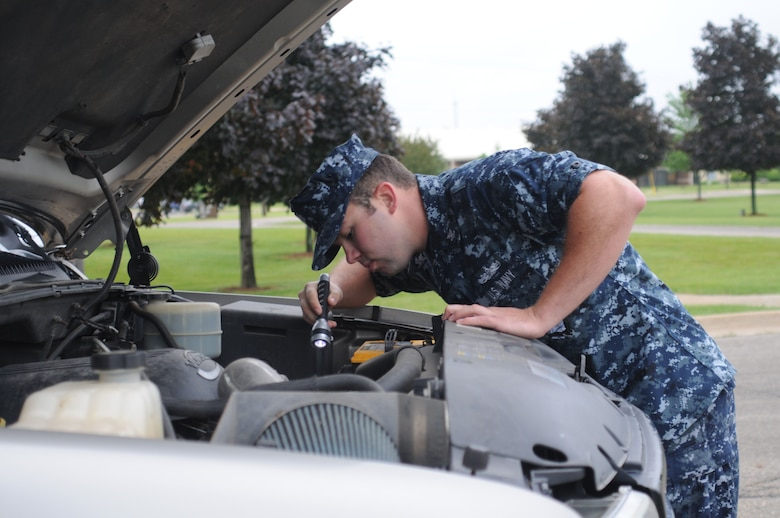U.S. Navy Petty Officer 2nd Class Kirk Cornell, Naval Operations Support Center Battle Creek, Mi., inspects a vehicle at the 110th Airlift Wing Air National Guard Base Battle Creek, Mi., June 6, 2010. Cornell was working with 110th Security Forces Squadron for additional training and to augment with security forces. (U.S. Air Force photo by Tech. Sgt. David Eichaker/released)