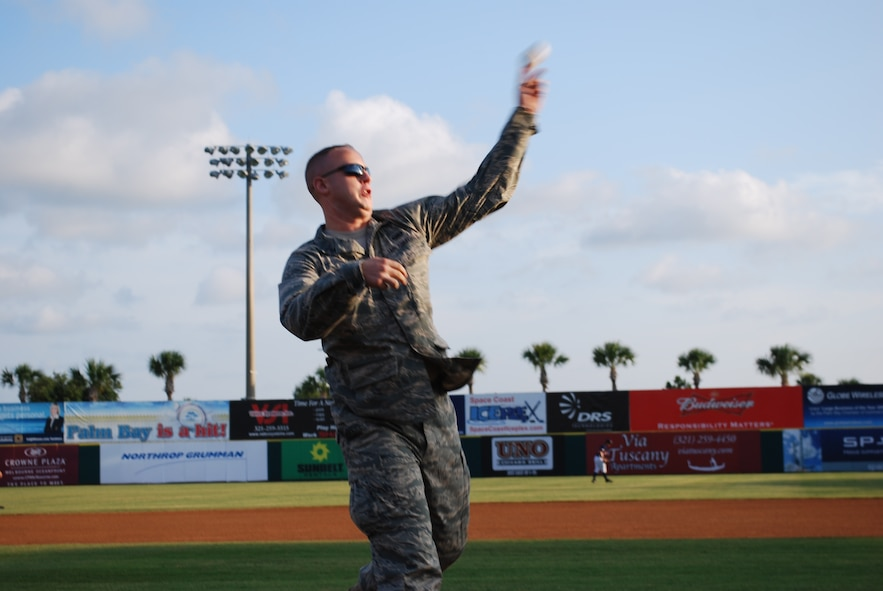 1st Lt Karl Wiest, 45th Space Wing, throws out first pitch