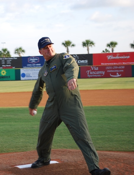 Col Philip Manning, vice commander, 920th Rescue Wing, throws out first pitch.
