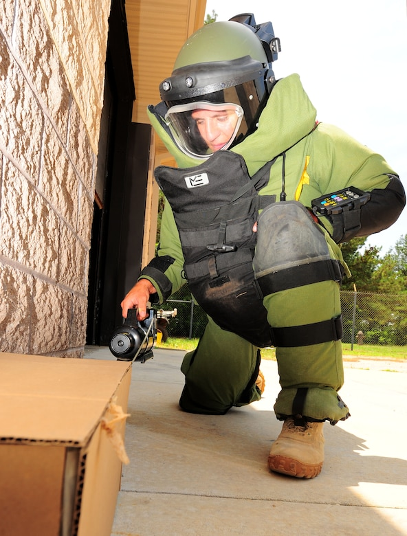 "100611-F-8454M-027 SHAW AIR FORCE BASE, S.C. -- Senior Airman Joshua Labott, 20th Explosive Ordinance Disposal apprentice, demonstrates techniques on disabling a suspicious package June 11, 2010. Airman Labott received the Bronze Star with the ""V"" for valor along with a purple heart for his actions in Afghanistan. (U.S. Air Force Photo/ Senior Airman David Minor)"