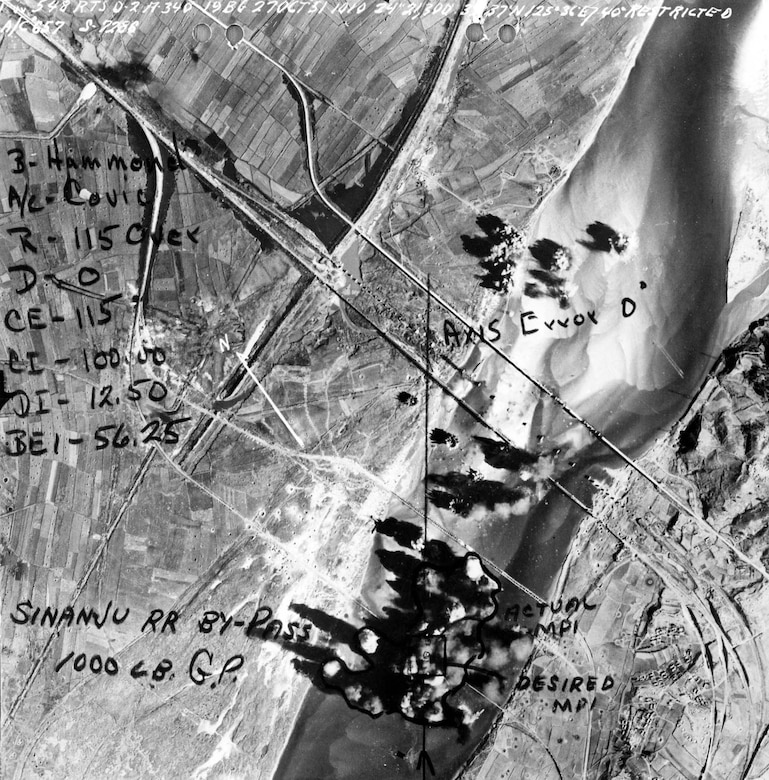 "On Oct. 27, 1951, ""Command Decision"" flew on a strike against rail bridges at Sinanju, North Korea. On this mission, the crew shot down their fourth and fifth MiG-15 (they shot down the other three on Oct. 17). This is the strike photo taken on the Oct. 27 mission. (U.S. Air Force photo)"