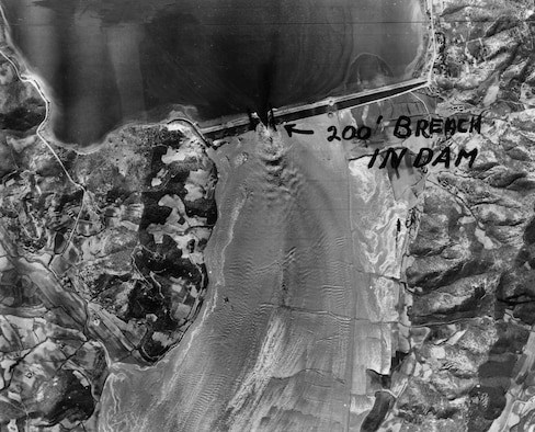 On May 16, 1953, F-84s scored several direct hits against the 230-ft thick Chasan Dam 25 miles north of Pyongyang, releasing a devastating flood. The torrent of water that raced down the valley washed out everything in its path, including roads, train tracks and two rail bridges. (U.S. Air Force photo)