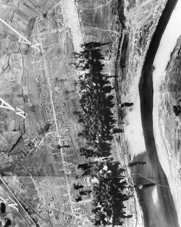 Superfortress bombs blanket the runway at Saamcham, about 50 miles north of Pyongyang. B-29 units regularly attacked North Korean airfields to deny the communists their use. (U.S. Air Force photo)