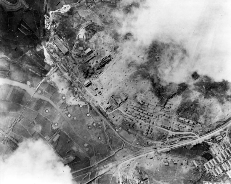 Post-strike photos of a munitions factory at Nakwon near Sinuiju, North Korea, on the Yalu River. On the night of Aug. 18, 1952, B-29s dropped 140 tons of bombs on it using electronic aiming methods. The attack destroyed fifteen buildings, including the main factory, and damaged 17 others. (U.S. Air Force photo)