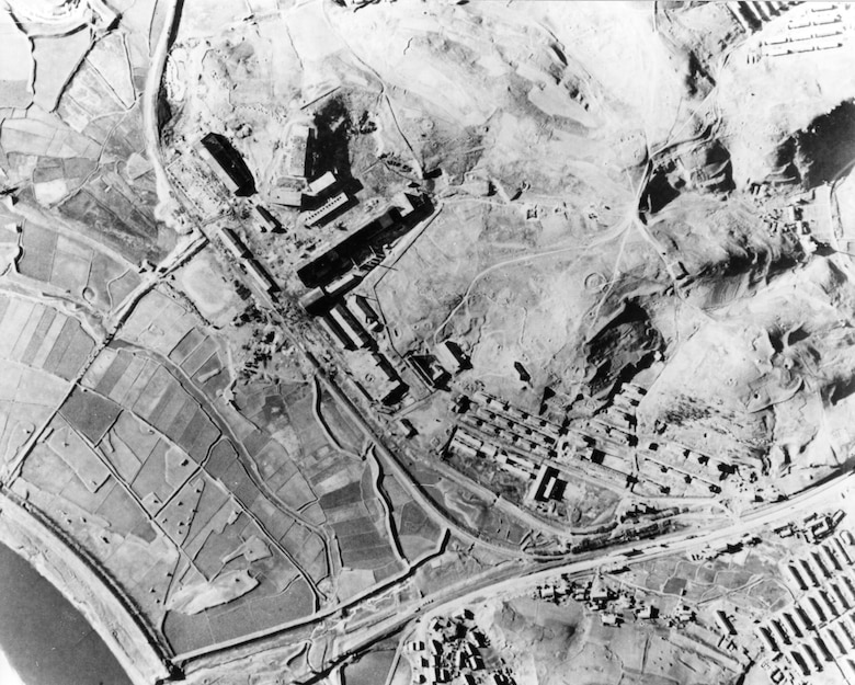 Pre-strike photos of a munitions factory at Nakwon near Sinuiju, North Korea, on the Yalu River. On the night of Aug. 18, 1952, B-29s dropped 140 tons of bombs on it using electronic aiming methods. The attack destroyed fifteen buildings, including the main factory, and damaged 17 others. (U.S. Air Force photo)