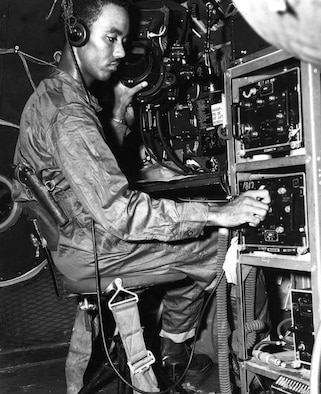 Superfortress radar observer with a pistol strapped to his side in case of bail out over enemy territory. (U.S. Air Force photo)